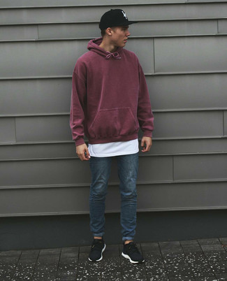 How to wear: black athletic shoes, blue skinny jeans, white crew-neck t-shirt, burgundy hoodie