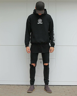 How to wear: dark brown suede chelsea boots, black ripped skinny jeans, black crew-neck t-shirt, black and white print hoodie