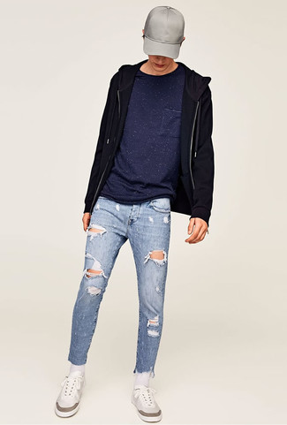 How to wear: white low top sneakers, light blue ripped skinny jeans, navy crew-neck t-shirt, black hoodie