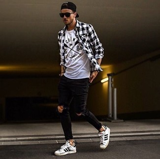How to wear: white and black horizontal striped leather low top sneakers, black ripped skinny jeans, white and black print crew-neck t-shirt, black and white gingham long sleeve shirt