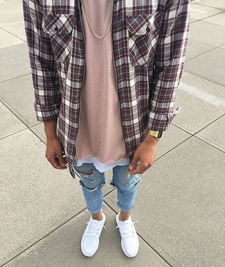How to wear: white athletic shoes, light blue ripped skinny jeans, pink crew-neck t-shirt, burgundy plaid long sleeve shirt