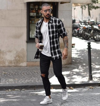 How to wear: white leather low top sneakers, black ripped skinny jeans, white crew-neck t-shirt, black and white plaid long sleeve shirt