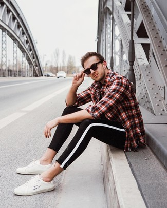 How to wear: white leather low top sneakers, black and white skinny jeans, black crew-neck t-shirt, red and black plaid long sleeve shirt