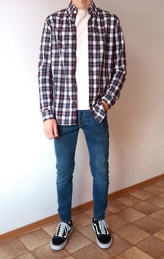 How to Wear Blue Skinny Jeans For Men: Dress in a white and red and navy plaid long sleeve shirt and blue skinny jeans if you're looking for an outfit idea that conveys modern casual style. Why not introduce black and white canvas low top sneakers to the equation for a dash of refinement?