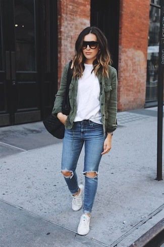 How to wear: white canvas low top sneakers, blue ripped skinny jeans, white crew-neck t-shirt, dark green military jacket