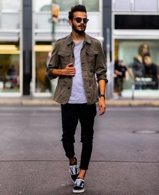 How to wear: black canvas low top sneakers, black ripped skinny jeans, grey crew-neck t-shirt, olive military jacket