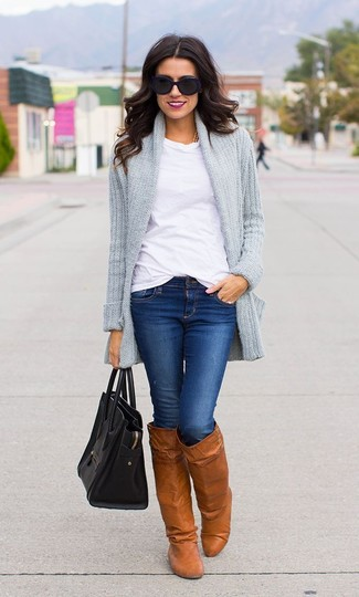 How to wear: tobacco leather knee high boots, blue skinny jeans, white crew-neck t-shirt, grey knit open cardigan