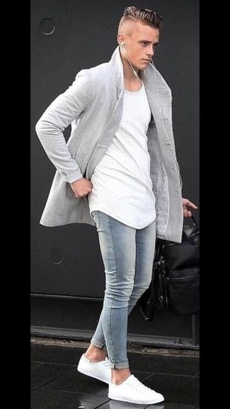 How to wear: white low top sneakers, light blue skinny jeans, white crew-neck t-shirt, grey overcoat
