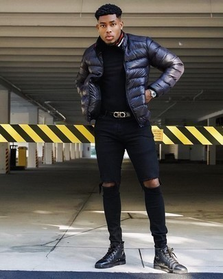 How to Wear a Navy Puffer Jacket For Men: This combination of a navy puffer jacket and black ripped skinny jeans is solid proof that a pared down casual getup can still be really interesting. Black leather high top sneakers are a good choice to complete this ensemble.