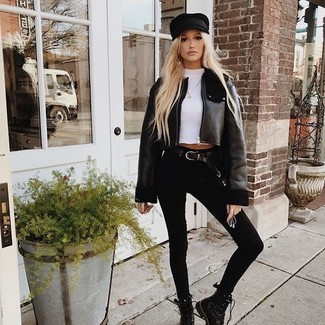 How to wear: black leather lace-up flat boots, black skinny jeans, white crew-neck t-shirt, black shearling jacket