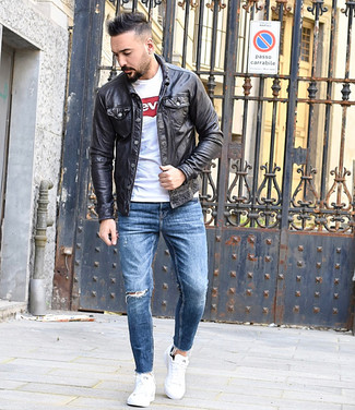 How to wear: white low top sneakers, blue ripped skinny jeans, white and red print crew-neck t-shirt, black leather shirt jacket