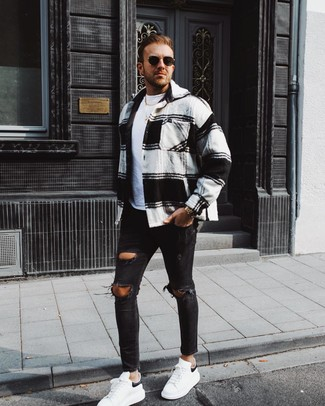 How to wear: white and black leather low top sneakers, black ripped skinny jeans, white crew-neck t-shirt, white and black plaid flannel shirt jacket
