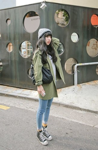 How to wear: black and white high top sneakers, light blue skinny jeans, grey crew-neck t-shirt, green trenchcoat