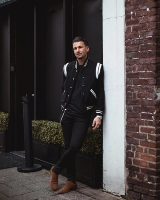 How to Wear Dark Brown Suede Chelsea Boots For Men: To pull together a laid-back ensemble with a city style finish, you can dress in a black and white varsity jacket and black skinny jeans. Add a different twist to an otherwise mostly dressed-down getup by sporting dark brown suede chelsea boots.