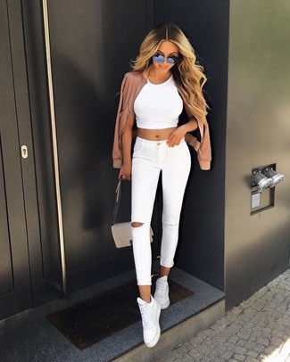 How to wear: white leather high top sneakers, white ripped skinny jeans, white cropped top, pink bomber jacket