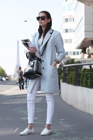 How to wear: white slip-on sneakers, white skinny jeans, white cropped top, light blue coat