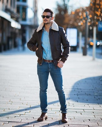 How to wear: brown leather casual boots, blue skinny jeans, light blue denim shirt, dark brown leather bomber jacket