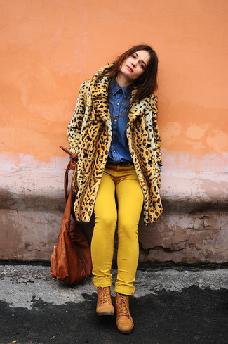 How to wear: tobacco leather lace-up flat boots, yellow skinny jeans, blue denim shirt, tan leopard fur coat