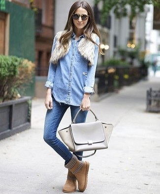 How to wear: tan uggs, blue skinny jeans, light blue denim shirt, beige fur shrug