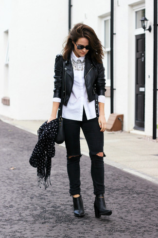 How to wear: black leather ankle boots, black ripped skinny jeans, white dress shirt, black leather biker jacket