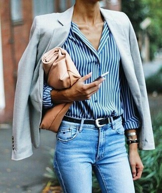 How to wear: tan leather clutch, light blue skinny jeans, white and blue vertical striped dress shirt, grey blazer