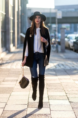 How to wear: black suede over the knee boots, navy skinny jeans, white silk dress shirt, black cape coat