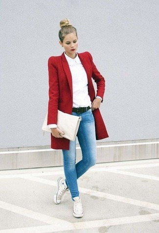 How to wear: white canvas high top sneakers, light blue skinny jeans, white dress shirt, red coat