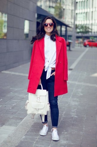 How to wear: white canvas low top sneakers, navy skinny jeans, white dress shirt, red coat