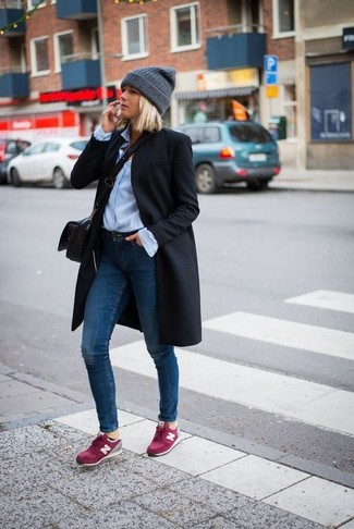 How to wear: hot pink suede low top sneakers, navy skinny jeans, light blue dress shirt, black coat