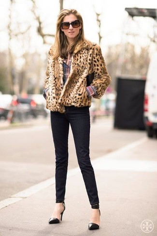 How to wear: black leather pumps, black skinny jeans, multi colored plaid dress shirt, tan leopard fur jacket