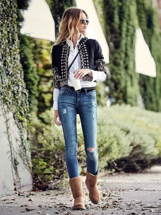 How to wear: brown uggs, blue ripped skinny jeans, white dress shirt, black embellished open jacket