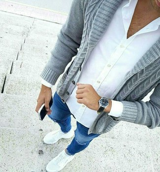 How to wear: white athletic shoes, blue ripped skinny jeans, white dress shirt, grey shawl cardigan