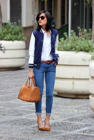 How to wear: brown suede pumps, blue skinny jeans, white dress shirt, navy and white varsity jacket