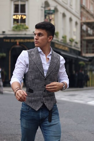 How to wear: black leather belt, blue skinny jeans, white dress shirt, white and black houndstooth waistcoat