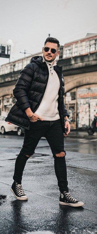 How to wear: black and white canvas high top sneakers, black ripped skinny jeans, beige henley sweater, black puffer coat