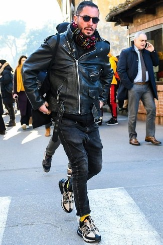 How to wear: black and white athletic shoes, black skinny jeans, black hoodie, black leather biker jacket