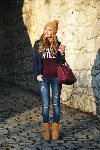 How to wear: brown uggs, blue ripped skinny jeans, burgundy print hoodie, navy quilted biker jacket