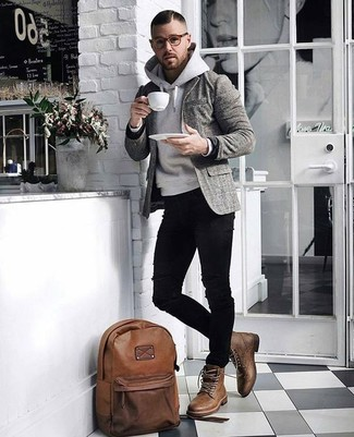 How to wear: brown leather casual boots, black ripped skinny jeans, grey hoodie, grey plaid wool blazer