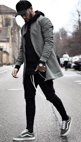 How to wear: olive canvas low top sneakers, black ripped skinny jeans, black hoodie, grey bomber jacket