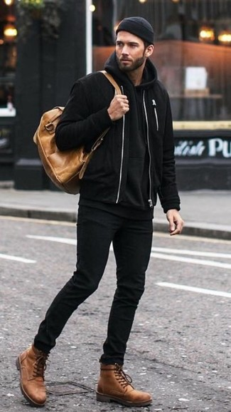 How to wear: brown leather casual boots, black skinny jeans, black hoodie, black bomber jacket