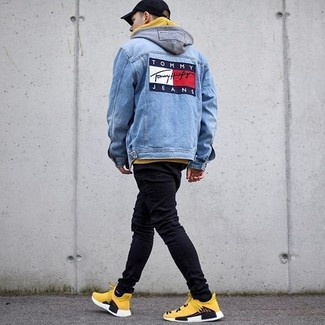 How to wear: yellow athletic shoes, black skinny jeans, yellow hoodie, blue denim jacket