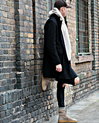 How to wear: beige suede high top sneakers, black ripped skinny jeans, white hoodie, black overcoat