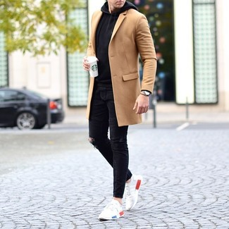 How to wear: white athletic shoes, black ripped skinny jeans, black hoodie, camel overcoat