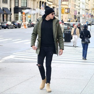 How to Wear Tan Suede Chelsea Boots For Men: Go for something urban in an olive parka and black ripped skinny jeans. And if you need to instantly up your ensemble with shoes, introduce a pair of tan suede chelsea boots to the equation.