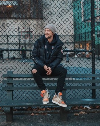 How to wear: tan leather high top sneakers, black ripped skinny jeans, navy print hoodie, black puffer jacket