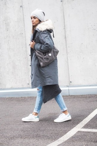 How to wear: white leather low top sneakers, light blue ripped skinny jeans, charcoal long cardigan, grey parka