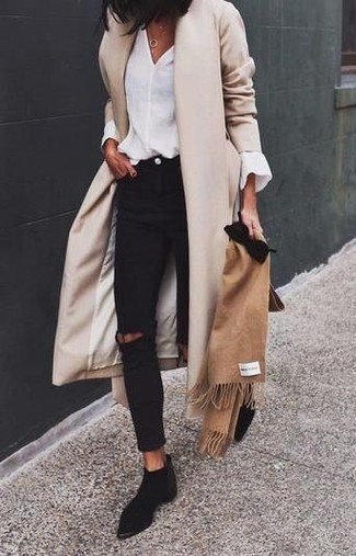 How to wear: black suede chelsea boots, black ripped skinny jeans, white long sleeve blouse, beige coat