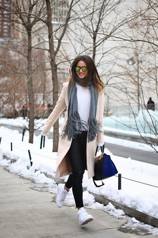 How to wear: white high top sneakers, black leather skinny jeans, white long sleeve blouse, beige coat