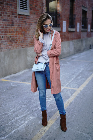 How to wear: dark brown suede ankle boots, blue skinny jeans, light violet long sleeve blouse, pink lightweight trenchcoat