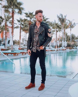 How to wear: tobacco suede chelsea boots, black skinny jeans, black paisley long sleeve shirt, black leather biker jacket